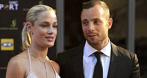 Reeva Steenkamp pictured with 'Blade Runner' Oscar Pistorius, who stands accused of her murder.