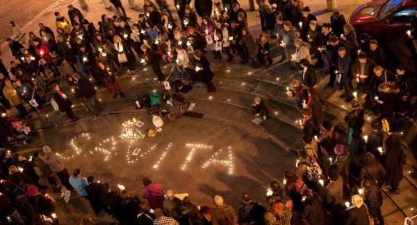 A candle-lit vigil for Savita, her name in candles on the ground.
